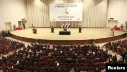 The November 11 parliament session saw Kurdish leader Jalal Talabani reelected as Iraqi president, and Talabani asking Nuri al-Maliki, a Shi'ite, to form a government for his second term as prime minister.