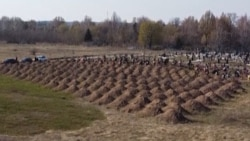 Ukrainian City Digs Mass Graves For Potential Coronavirus Victims