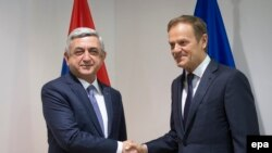 Armenian President Serzh Sarkisian (left) meets with European Council President Donald Tusk while in Brussels on February 27.