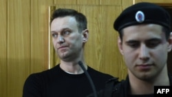 Russian opposition leader Aleksei Navalny attends a court hearing after being detained at a protest rally against corruption in Moscow on March 27.