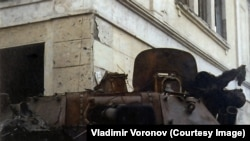 """A Russian armored vehicle """"684"""" with the remains of a soldier"""