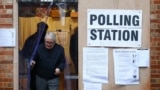 London, Britain - An elder leaves the garage of a residential house, converted to a poling station, to vote in the general election in South Croydon, in London, Britain, December 12, 2019