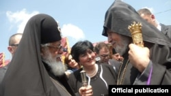 Catholicos-Patriarch Ilia II (left) greets Armenia's visiting Catholicos Garegin II on June 10.