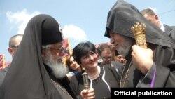Georgia - Catholicos-Patriarch Ilia II (L) greets Armenia's visiting Catholicos Garegin II at the Georgian-Armenian border, 10Jun2011.