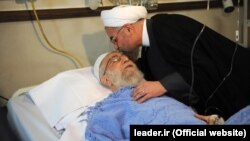 Iranian President Hassan Rohani visits Supreme Leader Ayatollah Ali Khamenei in the hospital on September 8.