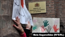 Hands off: a recent protest outside the Georgian Education Ministry