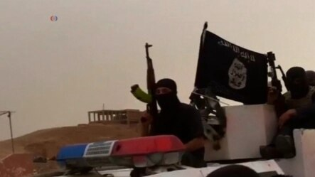 Membri ai grupării extremiste Statul Islamic din Siria.