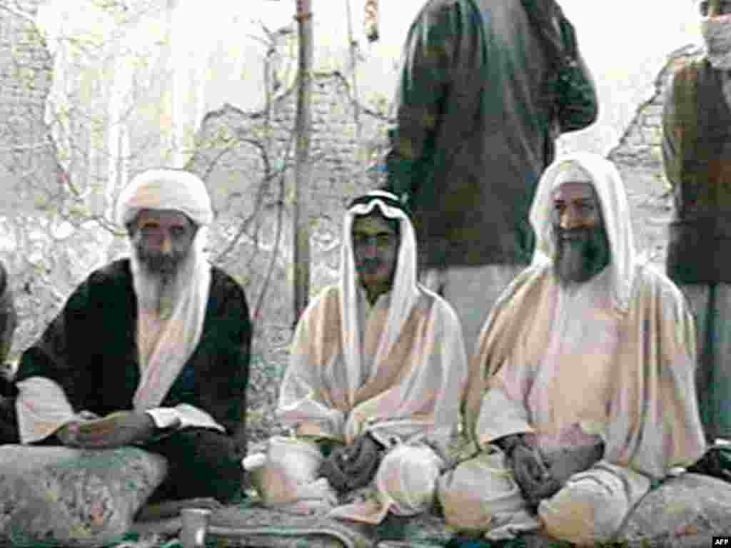Osama bin Laden (right) sits with his son Mohammed (center) and one of his top aides, Mohammed Atef, during Mohammed's wedding to Atef's daughter in Kandahar in January 2001.