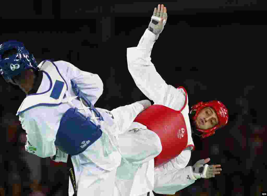 Radik Isaev of Azerbaijan (right) and Abdoulrazak Issoufou Alfaga of Niger in action during their men's 80-kilogram-plus taekwondo match. The 26-year-old Isaev won the gold. with Alfaga taking the silver, and Cha Dongmin of South Korea and Maicon Siqueira of Brazil sharing bronze.