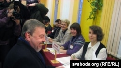 Andrey Sannikau voting on December 19, hours before the public protests began.