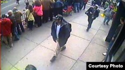 This surveillance-camera image of two Boston bombings suspects was released by the FBI on April 18.