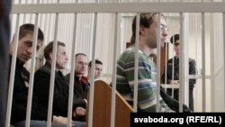 Election opponents of Belarusian President Alyaksandr Lukashenka sit in the dock in a Minsk courtroom on May 11