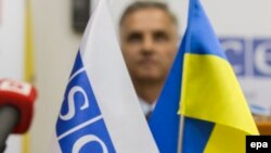Флаги ОБСЕ и Украины. Иллюстративное фото.