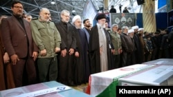 Iran -- Iranian supreme leader Ayatollah Ali Khamenei, center, leads a prayer over the coffins of Gen. Qassem Soleimani and his comrades at the Tehran University campus, January 6, 2019.