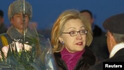U.S. Secretary of State Hillary Clinton is welcomed upon her arrival in Astana on November 30.