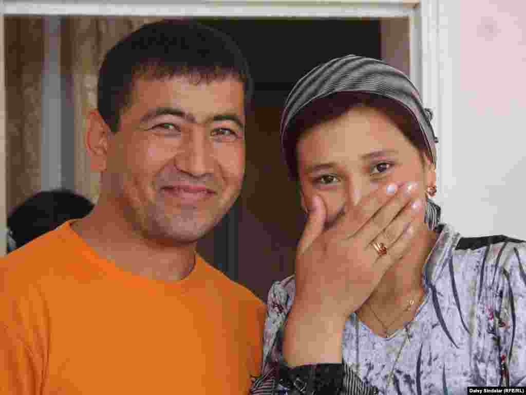 Sabyr Umurzakov, 27, who is Kyrgyz, and his new wife, Dilfuza Khashimova, 21, an ethnic Uzbek. The couple grew up within kilometers of each other in the area of Aravan outside Osh, which has the highest percentage of interethnic marriages in the region.Photo by Daisy Sindelar for RFE/RL