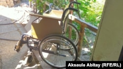 Kazakhstan – a wheelchair for teenage girl repaired by her father. Taraz, 20June2020