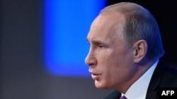 Президент России Владимир Путин. Москва, 18 декабря 2014 года.
