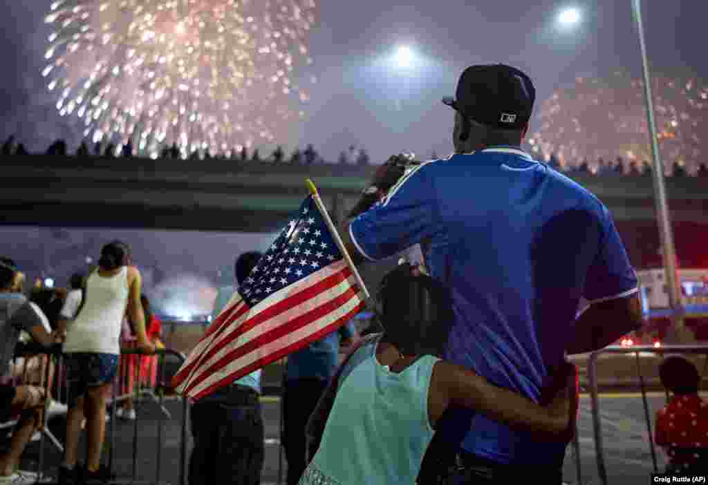 Spectators watch a fireworks display on the east side of Manhattan, part of Independence Day festivities on July 4 in New York. (AP/Craig Ruttle)