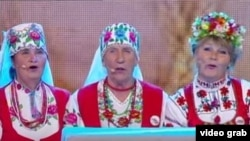 "The Belarusian grannies extol Alyaksandr Lukashenka's prowess on the farm. ""Lukashenka knows how to do everything, "" they sing."