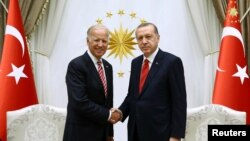 Turkish President Recep Tayyip Erdogan (right) meets with Joe Biden, then U.S. vice president, in Ankara in August 2016