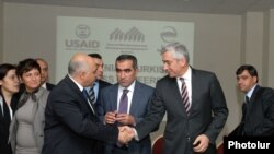 Armenian and Turkish entrepreneurs greet each other at the cross-border business forum in Yerevan.