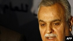 Iraqi Vice President Tariq al-Hashimi rejected the election law because he said it did not give enough representation to Iraqis who fled abroad.