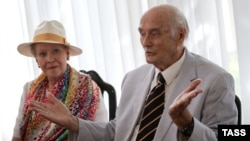 Prince Dimitry Romanovich Romanov of the House of Romanov and his wife, Dorrit Reventlow, talk to reporters at the airport in Simferopol, Crimea, in August 2015.