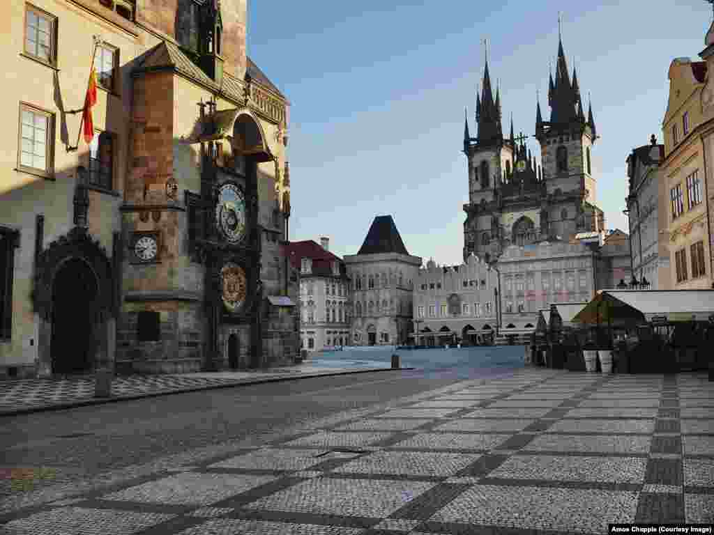 One of Prague's most famous sites, Old Town Square, stands nearly empty. This space is usually thronged with thousands of tourists.