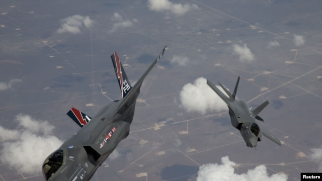 Two F-35 Lightning II planes, produced by Lockheed Martin, arrive at Edwards Air Force Base in California.