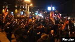 Opposition supporters rally against the results of the constitutional referendum in Yerevan on December 7.