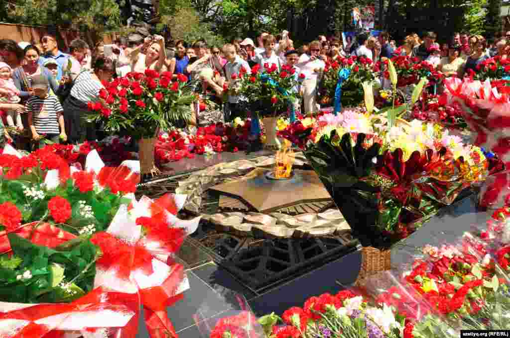 Flowers decorate the memorial flame in Panfilov Park in Almaty, Kazakhstan.