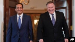 Secretary of State Mike Pompeo, right, walks with Qatari Foreign Minister Sheikh Mohammed bin Abdulrahman Al Thani, left, at the State Department, Wednesday, April 24, 2019 in Washington. (AP Photo/Pablo Martinez Monsivais)