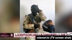 A television screenshot shows the gunman at the Bank of Georgia.