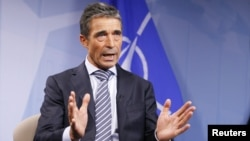 Belgium -- NATO Secretary-General Anders Fogh Rasmussen speaks during an interview with Reuters at the Alliance headquarters in Brussels, 03Sep2012