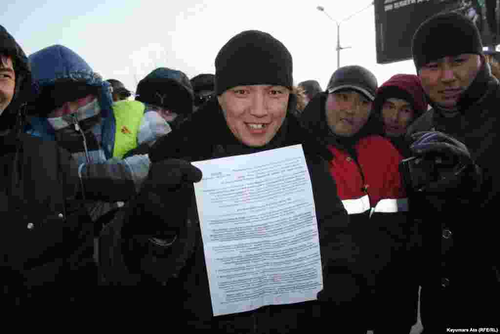 Protesters in Aktau present a list of their demands.