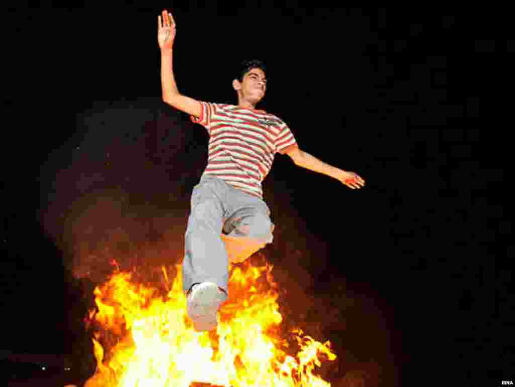 A boy jumps over a fire during the festival of Chaharshanbe Suri ahead of Norouz, the Persian New Year. - Iranians in Tehran celebrated Chaharshanbe Suri, the festival of fire, on March 16 by lighting bonfires and setting off fireworks, defying a ban on the festivities imposed by Supreme Leader Ayatollah Ali Khamenei. Photo by ISNA