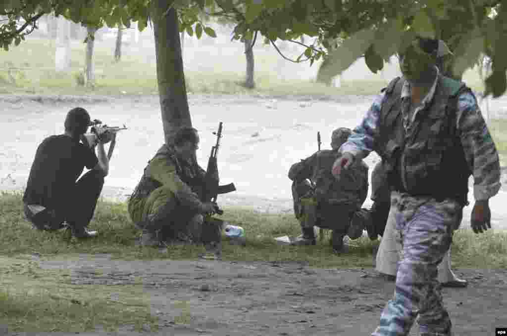 Russian soldiers take up positions in front of School No. 1 in Beslan after militants stormed the building on September 1, 2004.