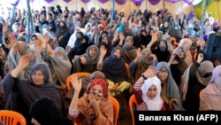 Members of the Shia Hazara minority sit-in during a protest in Quetta on April 15.