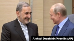Russian President Vladimir Putin (right) with Ali Akbar Velayati, a senior adviser to Iran's Supreme Leader Ayatollah Ali Khamenei, on July 12.