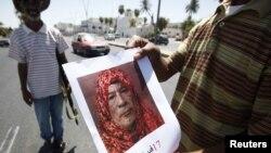 Ливия: разыскивается Муамар Каддафи.