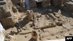 Afghanistan -- An archaeologist walks at the site of an ancient monastery discovered in Mes Aynak, in the eastern province of Logar, 23Nov2010