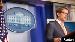 White House spokesman Jay Carney said President Barack Obama was ready to veto any legislation imposing new sanctions on Iran.