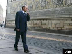 Vladimir Putin walks along a street in Dresden, where he was stationed from 1985 to 1990.