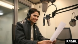 Asadullah Lodin, an Afghan student and aspiring journalist, practices his on-air skills during a media training at RFE/RL's Prague headquarters.