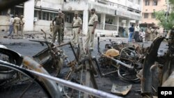 The aftermath of one of 16 bombs that rocked the Indian city of Ahmedabad on July 26