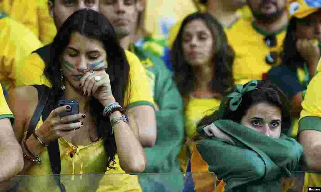 Разочарованные болельщики бразильцев.