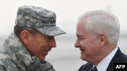 ISAF commander General David Petraeus greets U.S. Defense Secretary Robert Gates (right) in Kabul.