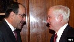رئيس الوزراء العراقي نوري المالكي يلتقي بوزير الدفاع الأميركي روبرت غيتس في بغداد، 28 تموز 2009