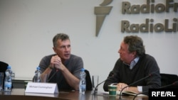 "Michael Cunningham (left) discussing ""By Nightfall'' at RFE in Prague."